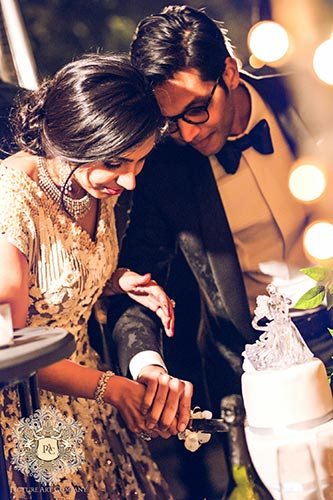Nayana and Jai | Amazing Delhi wedding | Proposal story | Proposal ideas | The bride and the groom cutting the white velvet cake.