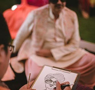 Sagar and Subiya | Destination wedding in Bali | The sketch artists making beautiful sketches.