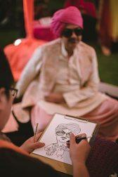 Sagar and Subiya   Destination wedding in Bali   The sketch artists making beautiful sketches.