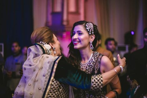 Sagar and Subiya | Destination wedding in Bali | The bride sharing a happy moment with a family member.