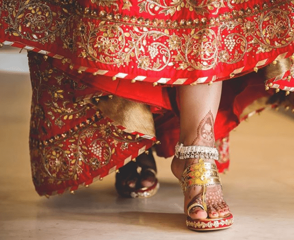 Red wedges with red lehenga