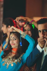 Nimisha and Hemant | Temple wedding in Delhi | Friends and family whistling during the fun functions.