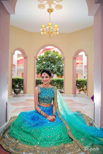 Dipak studios | bride in a pretty sea green and blue seafood lehenga |dupatta draped on one shoulder | dupatta draping styles we love