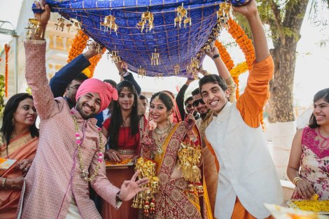 Nimisha and Hemant   Temple wedding in Delhi   The bride entering her wedding day with the boys dancing in the front.