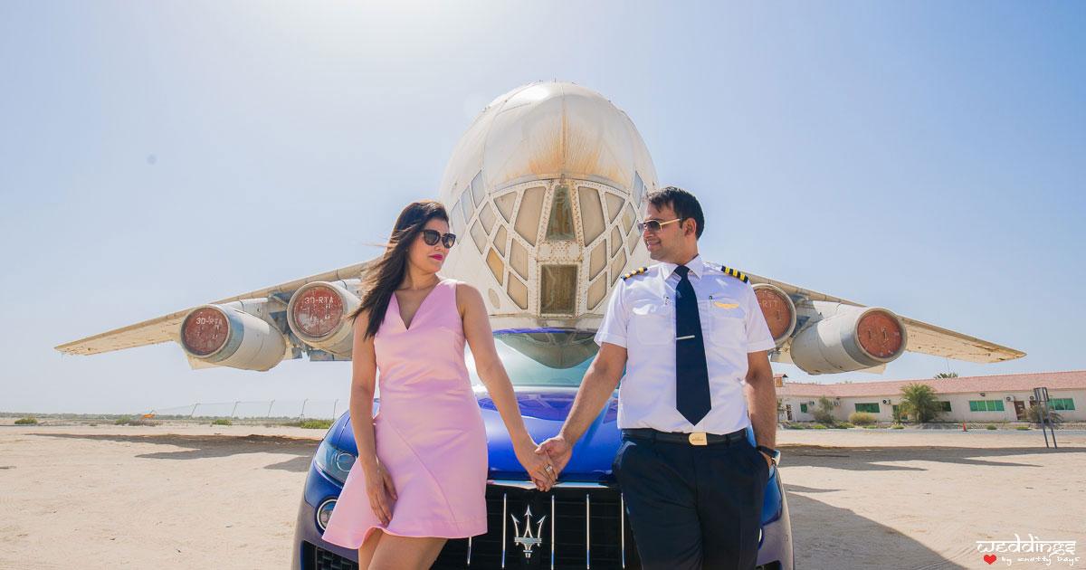 first anniversary idea, anupriya and ankit, aniversary photoshoot   post wedding shoot in Dubai   idnain couple photo in front of a plane