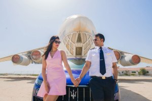 first anniversary idea, anupriya and ankit, aniversary photoshoot | post wedding shoot in Dubai | idnain couple photo in front of a plane