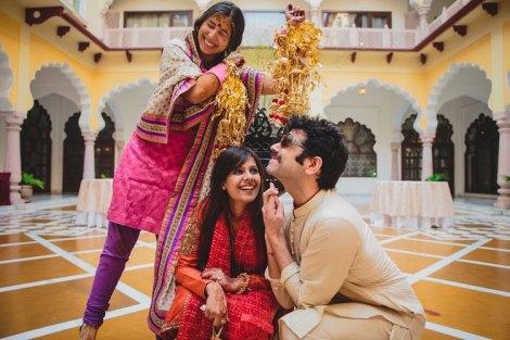 Nimisha and Hemant | Temple wedding in Delhi | The bride showering her kaleera on her bridesmaid.
