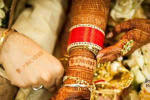 Karishma and Jyotveer | Anandkaraj | Sikh wedding in Delhi | The bride and the groom flaunting their hashtag through mehendi.