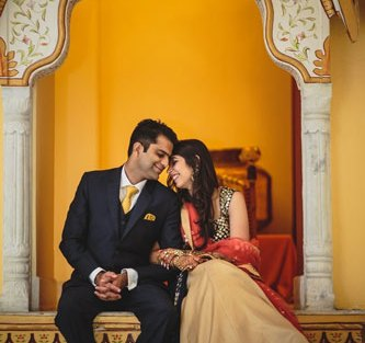 Nimisha and Hemant   Temple wedding in Delhi   The bride and the groom sitting together and seeing in each other's eyes in a beautiful backdrop.