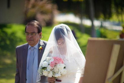 Joshua and Shona   Christian wedding   DIY ideas   The bride in the veil walking with her father.