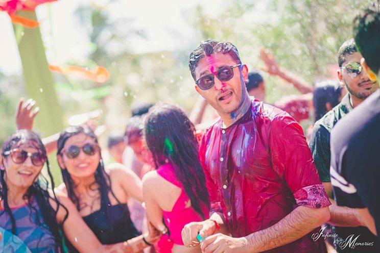 Siddharth and Rutika | Super cute Goa wedding full of beach wedding ideas | photo by Infinite Memories  | raindajnce and holi party