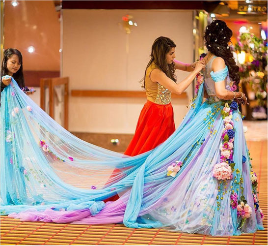 Indian bride wearing a gorgeous floral gown