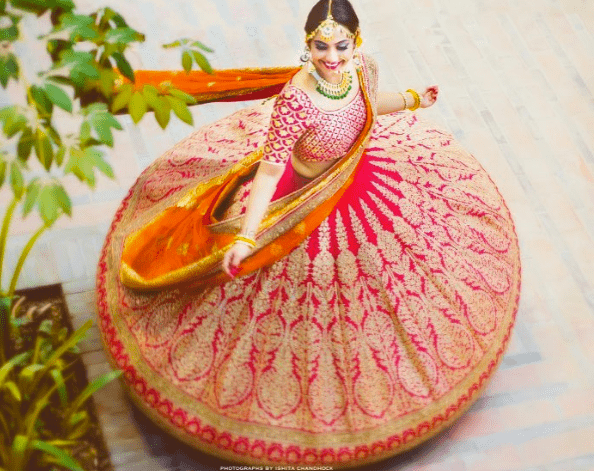 Bride twirling in her comfortable lehenga