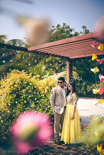 Khushboo and harshang - Gujarati wedding with fun wedding ideas | bride in a yellow gown with a pretty flower background | origami birds hanging