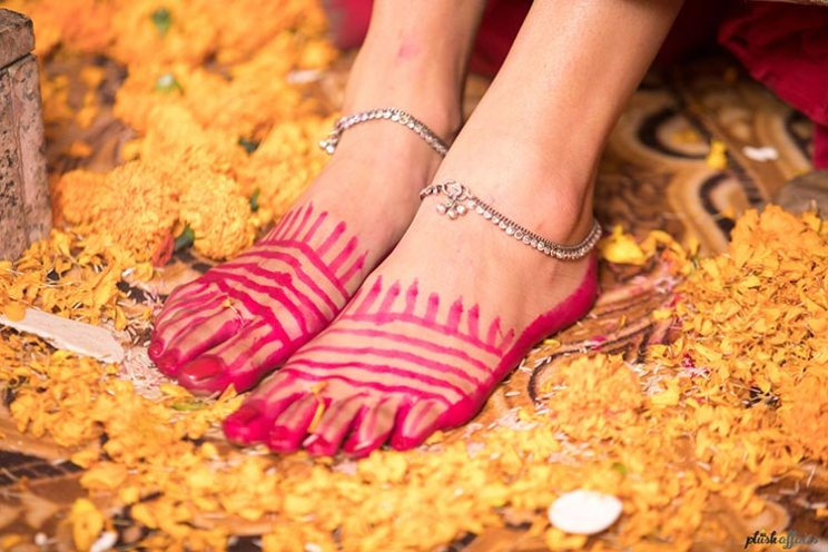 aditi and Rohan | Delhi weddng for a model bride | plush affairs photography | bride with red Alta on her feet