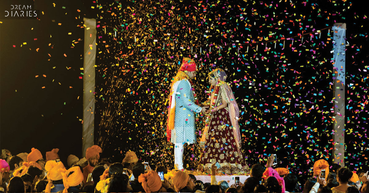 Anchal and Nikhil | super fun Goa Wedding by Crayon entertainment | destination wedding in Goa full of ideas | Jaimala moment with fireworks and confetti showers