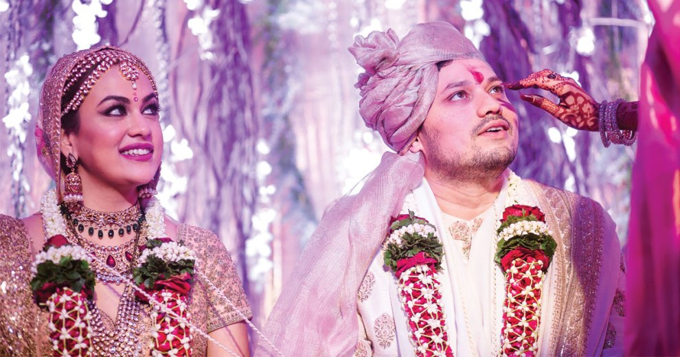 Mihir and Disha - Magical Mumbai wedding | Indian bride and groom doing jaimala in a pretty forest theme wedding