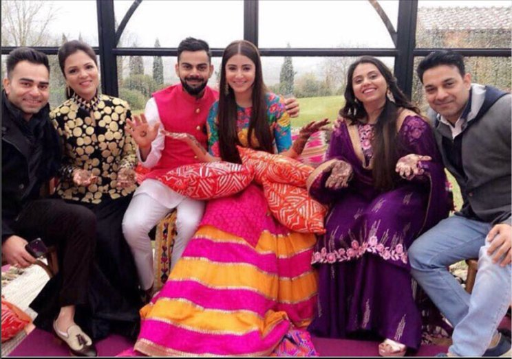 virat kolli and Nanushka sharma wedding in Tuscany | Anushka sharma in a pink and orange Sabyasachi skirt and elbow sleeve blue printed top by sabyasachi