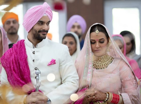 Neha Dhupia Wedding | Neha Dhupia And Angad Bedi at their Anandkaraj in Delhi