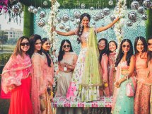 Beautiful bride on a swing with her bridesmaids | Photo by Morvi Images | Whte printed lehenga | swing ideas