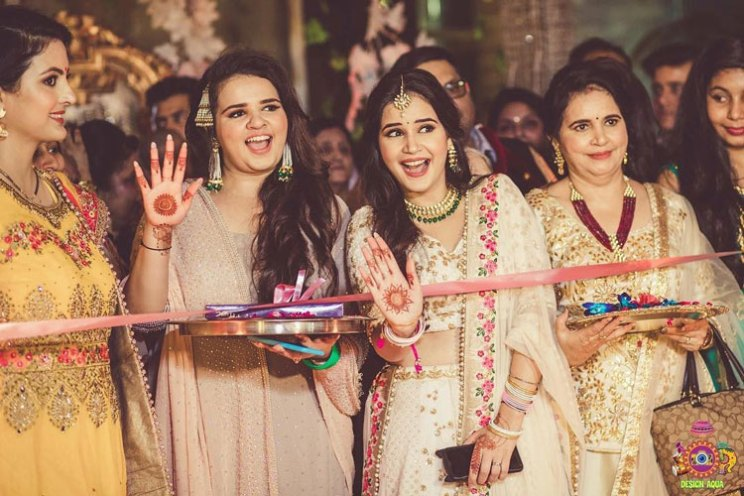 Sister of the bride   Indian bridesmaids   Shiv Shakti Sachdev   Indian weddings   Maid of Honour   Indian wedding Photography   Photos every bridesmaid needs   Candid pictures   Ribbon cutting ceremony