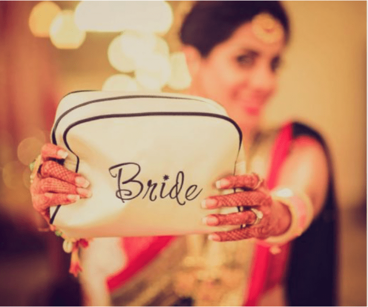 Bride holding Makeup Kit