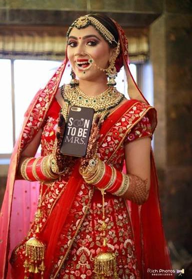 Meghna Sadhwani | Getting ready photo shoot of bride | bridal photo shoot | Bridal Swag | Bridechilla | Swagger Bride | Personalized accessories | Robe | Red Lehenga | personalised phone case |