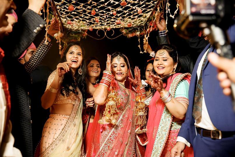 Danditi | Dhanurdhar and Aditi | Delhi Wedding | Holi Party | Destination weddings | Indian brides | Indian wedding Photography | Personalised Cute Details | Smoke Bombs in Holi Party | Mehendi decor ideas | Mehendi ideas | Bride and groom | Candid Couple Photography |