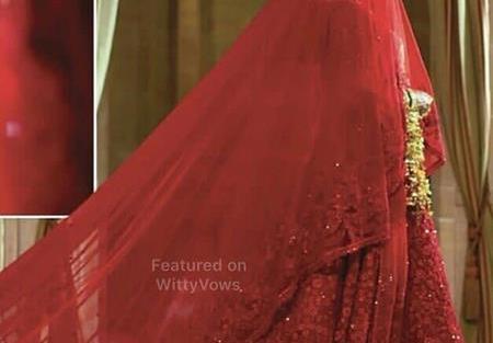 Priyanka Chopra and Nick Jonas Wedding | Priyanka Chopra in red custom sabyasachi lehenga with trail |