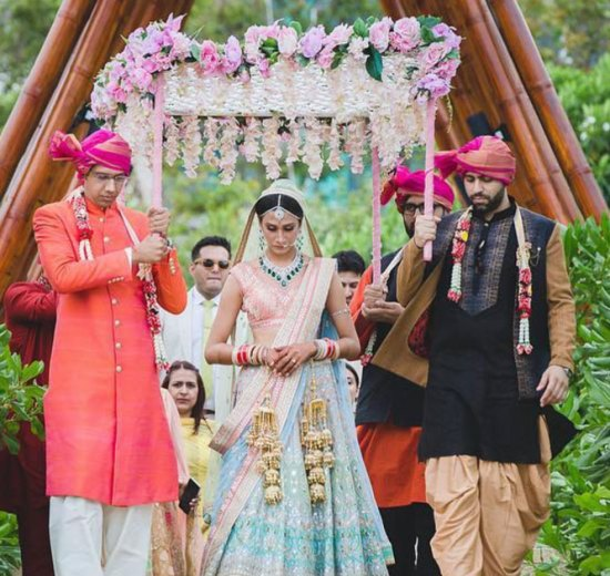 pretty day wedidng bride in pastel lehenga under a white and pink phoolon ki chaadar | bridal entry ideas