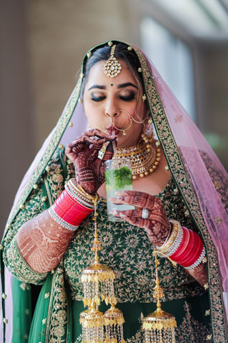 Real Indian Bride | bridal Photography | plus Size fashion | Chura | Bridal makeup | Sikh bride | Green Lehenga |