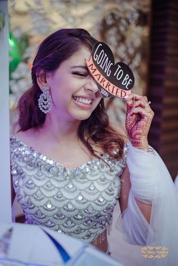 Cute bridal potraits | Photobooth props | engagement oufit | Indian celebrity Niti Taylor engagement ceremony | Silver bridal lehenga