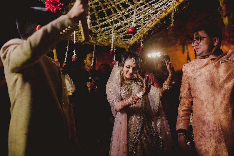 bride walking down the aisle   A dreamy wedding of Priyanka and Parth in Udaipur