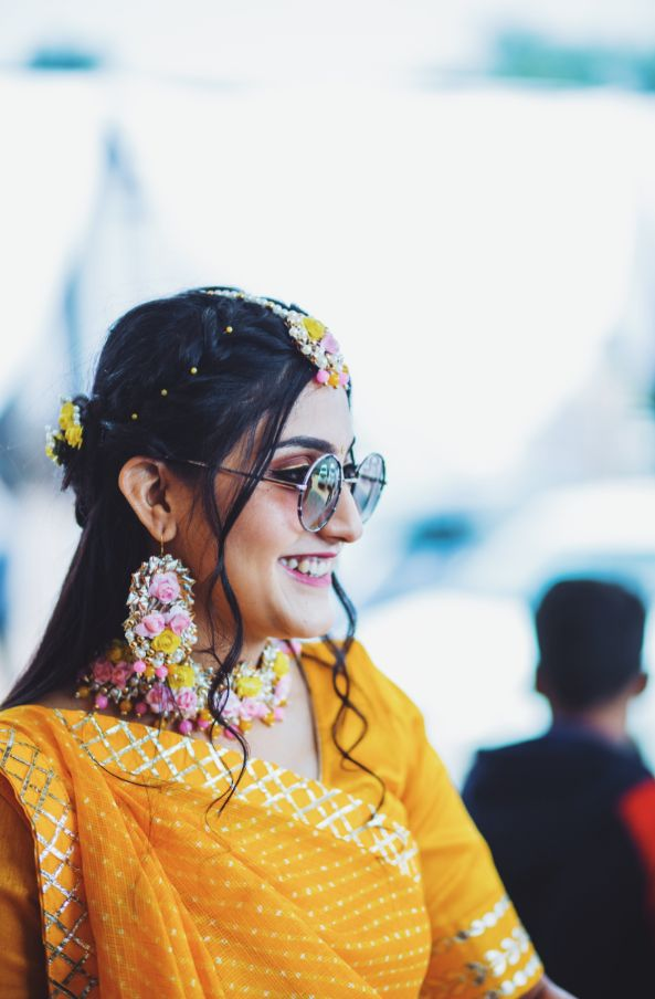 Bride during her haldi ceremony | floral jewellery ideas | A beautiful love story of Stuti and Mukul, the high school sweethearts | A beautiful love story of high school sweethearts