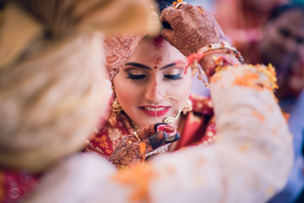 special moment for a bride | groom putting sindoor in brides maang