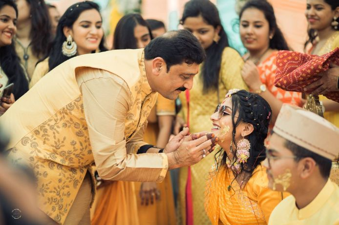 father and daughter | haldi ceremony photos | A beautiful love story of Stuti and Mukul, the high school sweethearts.