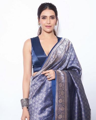 Karishma Tanna in a blue banarasi saree paired with a deep V-neck blouse | Trending new fashion | indian Fashion | Indian Wedding Blog