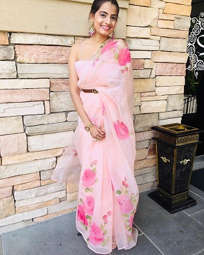 Saree clutched with a leather belt | Floral prints | Summer sarees | Pink saree | Flower vibes