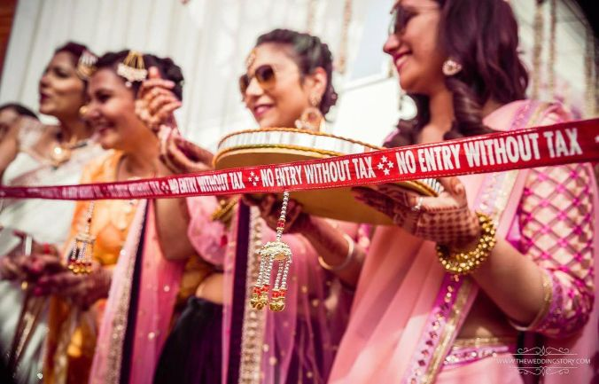 Brides maid at ribbon cutting ceremony   groom welcome ideas   how to welcome your jiju ideas