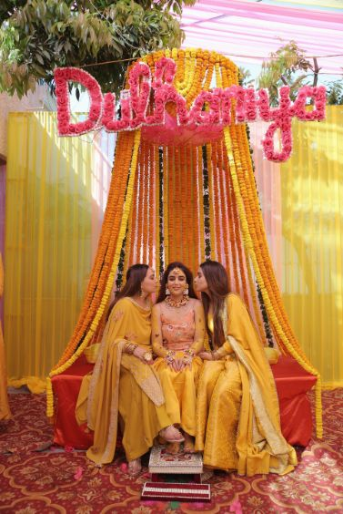 beautiful marigold decor for bridal seat | Karishma & Pratham - a love story of two advocates