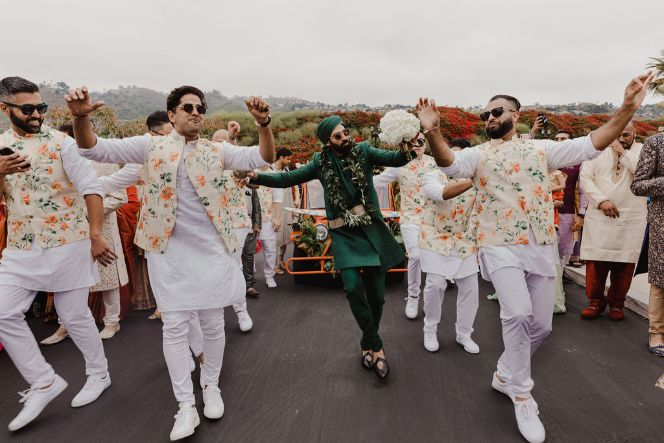 Ankur dancing with the baarat | coordinated outfits of the groomsmen | a stunning wedding in california