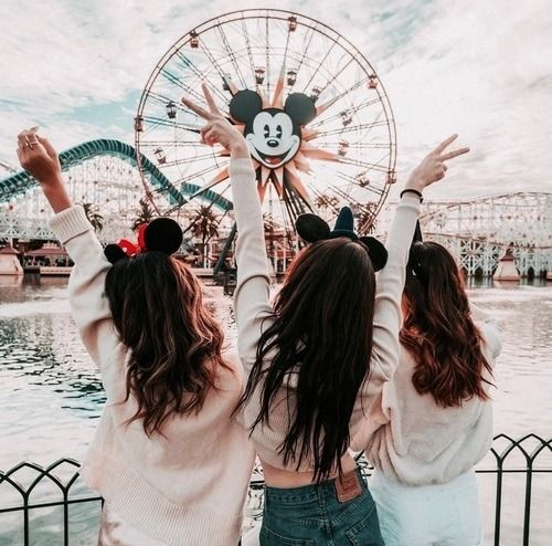 friends enjoying at disneyland | destination ideas for a bachelorette party