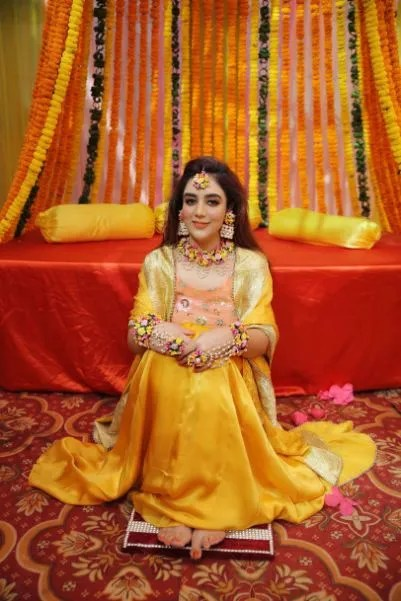yellow outfit of a bride for haldi ceremony | Karishma & Pratham - a love story of two advocates
