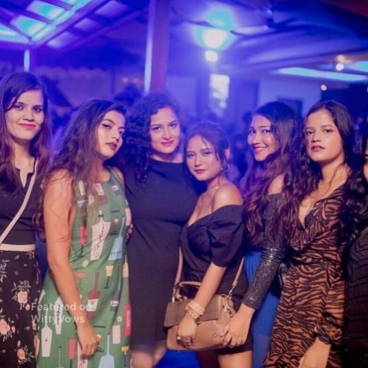 bride partying with her friends   trending party ideas trending now  