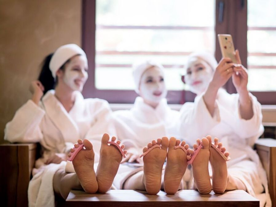girls enjoying on spa   relaxing mode on   destination ideas for a bachelorette party