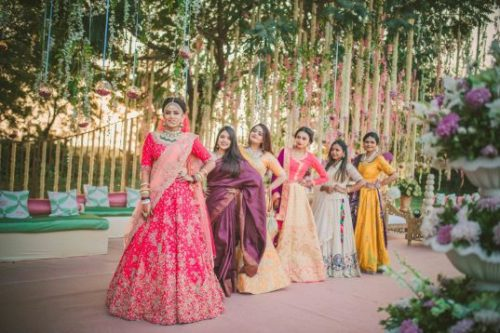 bridesmaids at photoshoot | stunning Indian bride in bridal lehenga