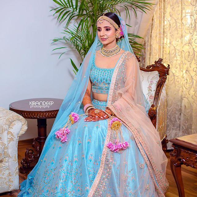 twirling bride in blue lehenga | blue bridal lehenga | coral blue lehnga style | latest blue lehenga | punjabi bride | big fat indian wedding 2020 | maroon lehenga | sea blue bridal lehnga | latest bridal lehenga | pastel lehenga | pastel Lehenga Colour trends | | wittyvows | 2020 lehenga trends for indian brides | chooda designs | #wittyvoes #lehenga #2020bridallehenga #bridallehengacolours #lehengacolours #pastelehenga #bluelehenga #bridesofwittyvows
