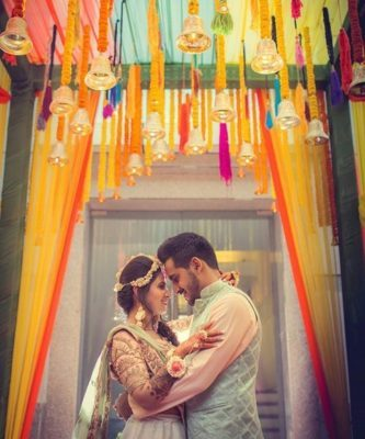 indian couple mehendi outfit | diy mehendi decor | floral decor ideas for home weddings in 2020 floral string decor for home fucntions and indian weddings | floral decorations for indian weddings at home 2020 | decor ideas to diy at home for weddings | mehendi function #mehendidecor #diydecor indian wedding decor for home fucntions | wedding decor ideas for home wedding due to corona #decorideas #wittyvows #indianwedding #homeweddings #housewedding #indianbride