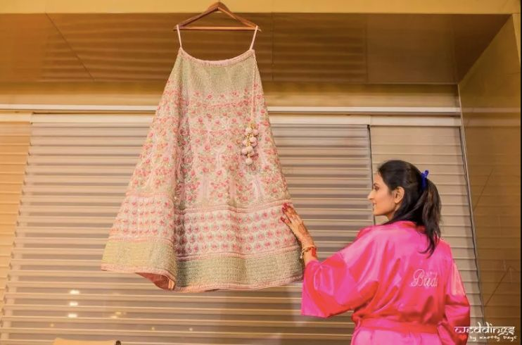 pink lehenga for indian brides of 2020 , getting ready shots for indian brides swag poses