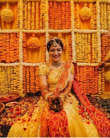 bride during her haldi ceremony